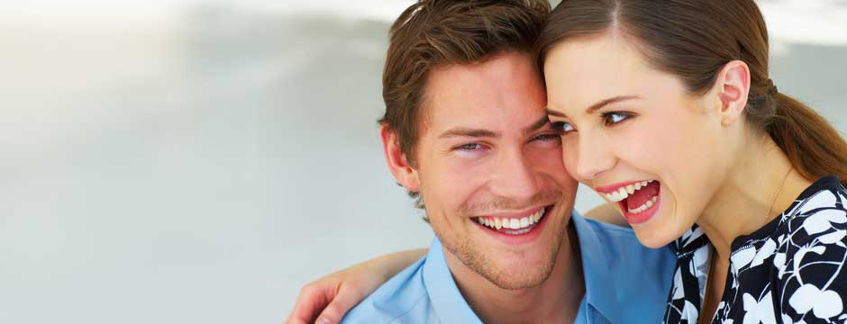 Happy couple smiling after their visit to Dr. Wilkins Family Dentistry